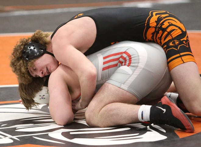 Blake Schaffer of Green (top) defeated Anthony Rizzo of Brecksville in a 182 pound bout during day two of the DI district wrestling tournament at Hoover on Saturday, March 6, 2021.