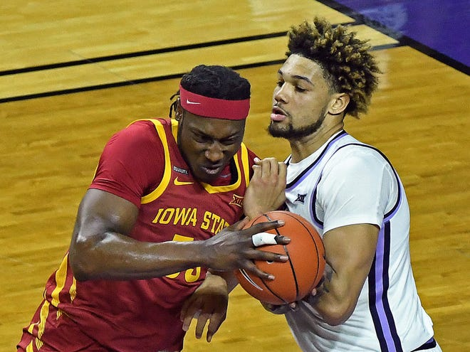 Iowa State's Solomon Young and Kansas Sate center Davion Bradford battle for position near the basket during Saturday's regular-season finale at Bramlage Coliseum.