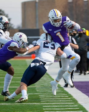 Kansas Wesleyan's Stevie Williams (1) was one of four Coyotes to earn first-team all-Kansas Conference honors announced by the league Friday.