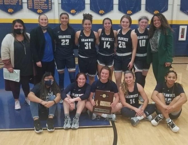 The Shawnee girls pose with their area runner-up trophy Saturday after staging a major comeback in defeating Altus 50-48 in Piedmont.