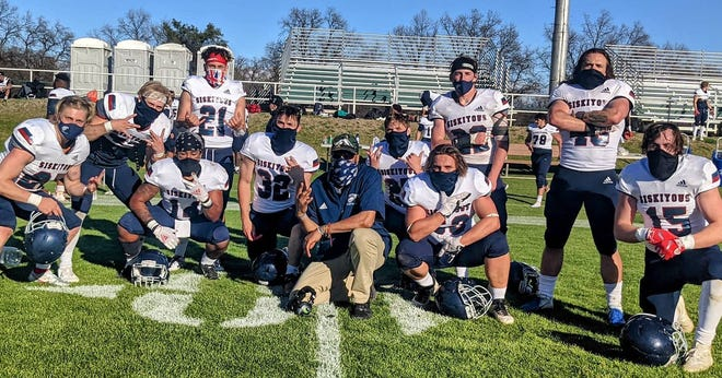 Members of the College of the Siskiyous football team pose for a photo after Saturday's win at Shasta College.