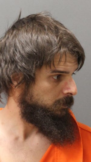 Shane Hart accused of of pouring liquid onto Plainfield police cruisers on Sunday