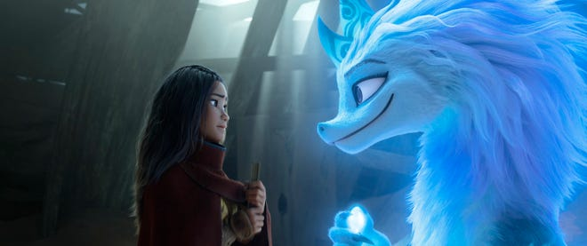 """Animated character Raya, voiced by Kelly Marie Tran, left, appears with Sisu the dragon in a scene from """"Raya and the Last Dragon."""""""