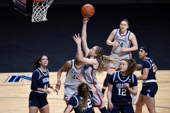 Connecticut's Paige Bueckers, center, shoots as Villanova's Bella Runyan (32) defends during the first half of an NCAA college basketball game in the Big East tournament semifinals at Mohegan Sun Arena on Sunday in Uncasville.