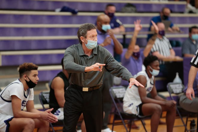 Topeka West coach Rick Bloomquist yells out plays during the first half of Saturday's Class 5A sub-state championship game against Seaman. The Chargers won 55-52.