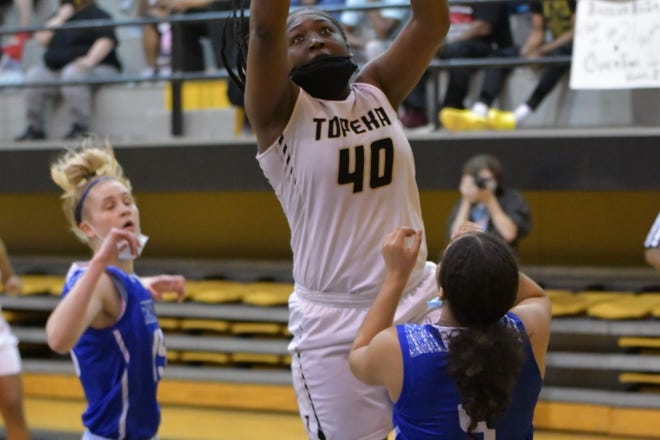 Topeka High's NiJaree Canady scored 19 of her team-high 21 points in the second half to power the Trojans to a 72-52 win over Rural in the Class 6A sub-state championship game Saturday at Topeka High.