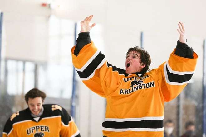 Upper Arlington's Garrett Alderman celebrates moments after a 2-1 win over St. Charles in the district final March 6 at OhioHealth Ice Haus.