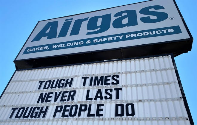 A sign at an Abilene business speaks for 2020 ... and 2021, after the recent winter storm. The city has dealt with COVID-19 the past 12 months.
