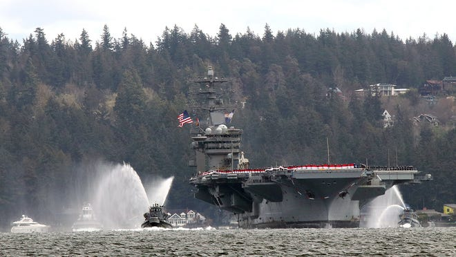 The USS Nimitz makes the turn in Rich Passage towards Bremerton from Bachmann Park in Manette on Sunday, March 7, 2021.
