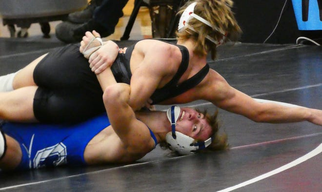 Chillicothe senior Caleb Lake wrestles Mount Vernon junior Gabe Shannon in a 138-pound consolation match during Sunday's Division I district tournament at Hilliard Darby. Lake placed fourth at 138 pounds to qualify for state.