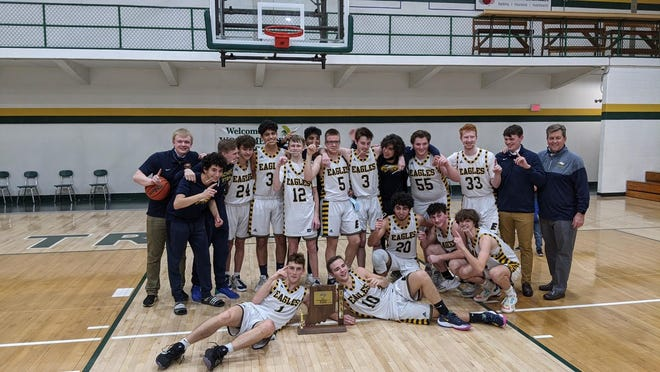 The Day School boys basketball team celebrates its Class 1A sectional title at Wood Memorial.