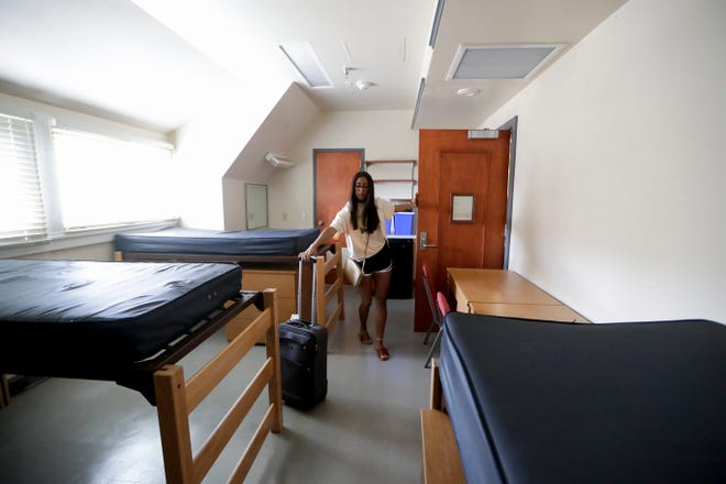 Freshman Sophia Arevalo, 18, begins to move her things into her new Murphee Hall dorm room during move-in day at Florida State University Thursday, August 22, 2019.