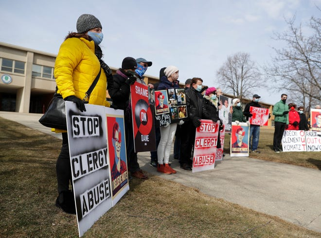 Family, friends and supporters of Nate Lindstrom, who died by suicide at age 45 after reporting he was sexually abused by priests as a child, participate in a memorial rally held outside Notre Dame Academy in Green Bay on March 7.