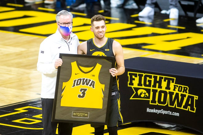 Iowa guard Jordan Bohannon poses for a photo with Iowa head coach Fran McCaffery on senior day before a NCAA Big Ten Conference men's basketball game against Wisconsin, Sunday, March 7, 2021, at Carver-Hawkeye Arena in Iowa City, Iowa.