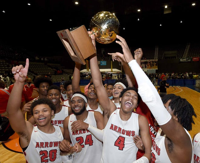 The Clinton Arrows celebrate winning the MHSAA Class 6A State Basketball Championship on Saturday, March 6, 2021, at the Mississippi Coliseum in Jackson, Miss.