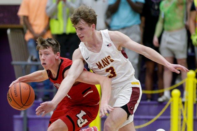 Lafayette Jeff's Jacob Collicott (24) dribbles against McCutcheon's Brock Dimmitt (3) during the first quarter of an IHSAA boys basketball sectional championship game.