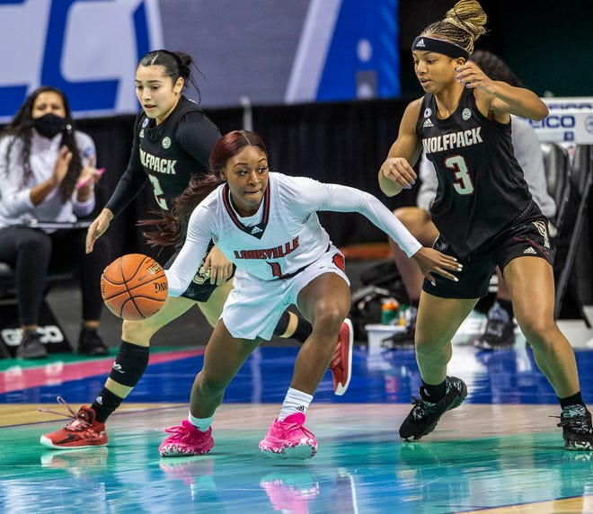 Louisville's Dana Evans runs the offense during the Atlantic Coast Conference Women's Championship with N.C. State at the Greensboro Coliseum in Greensboro, N.C., on Sunday, March 7, 2021.