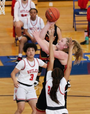 Bullitt East's Gracie Merkle (44) shoots against a Butler defender during the LIT at the Valley High School in Louisville, Ky. on March 7, 2021.
