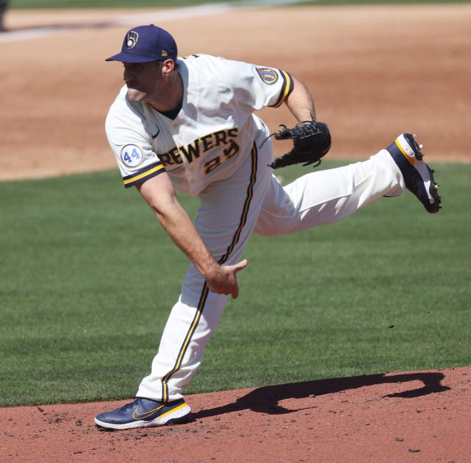 Josh Lindblom of the Brewers delivers a pitch during a spring training game this month.