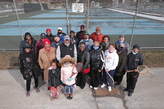 Members of the former Badger Racquet Tennis Club and supporters gather outside the tennis courts at Sherman Park in Milwaukee. Efforts are underway to rejuvenate tennis in Sherman Park.