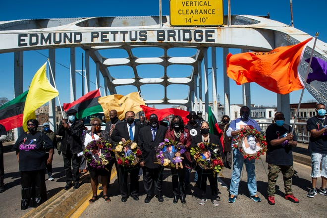 Martin Luther King III, from left, civil rights icon Bernard Lafayette, Rep. Teri Sewell and foot solider Sheyann Webb-Christburg lead the march during the 56th Selma Bridge Crossing Jubilee on the Edmund Pettus Bridge in Selma, Ala., on Sunday, March 7, 2021.