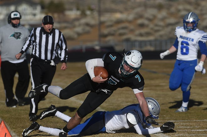 North Valleys' Cameron Zeidler gets pushed out of bounds while taking on McQueen on March 6, 2021.