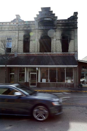 The exterior of the Laack building in the 200 block of East Mill Street in blackened from an apartment fire on Saturday.