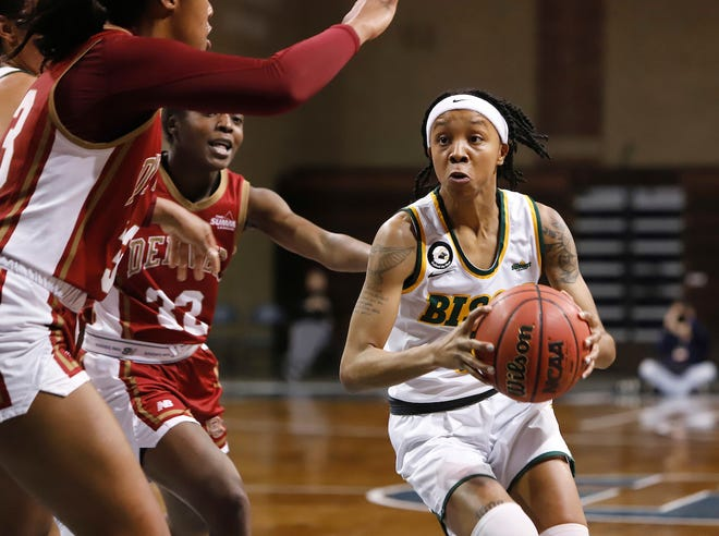 Reneya Hopkins #0 of the North Dakota State Bison drives to the basket against the Denver Pioneers during the Summit League Basketball Tournament at the Sanford Pentagon in Sioux Falls, SD.