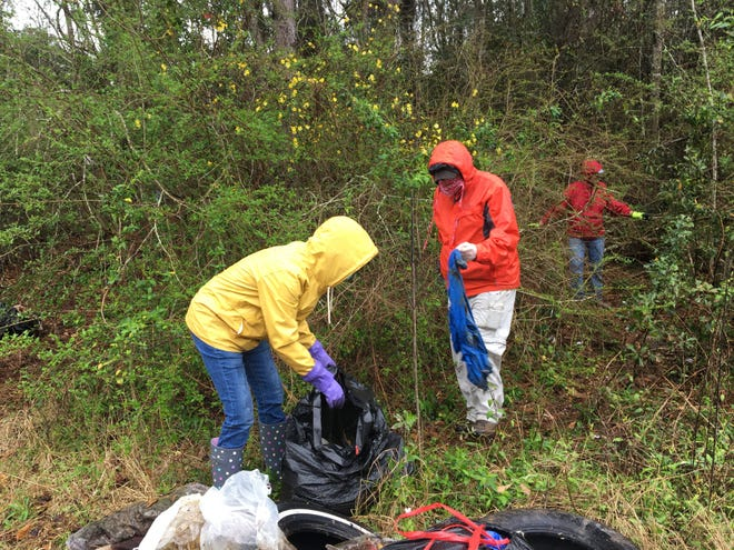 Big Bend Catholics for Creation Care gather litter from abandoned campsite near the Centre of Tallahassee on Saturday, March 6, 2021, as part of the 26th annual Super-Clean Sweep, organized by Keep Tallahassee Beautiful. From left: Suzanne Printy, Don Ruane and Charlie LaRoque.
