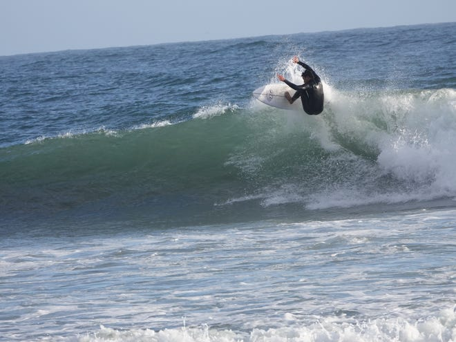 A surfer rides the crest of a wave at Rincon Point on Saturday, March 6, 2021.