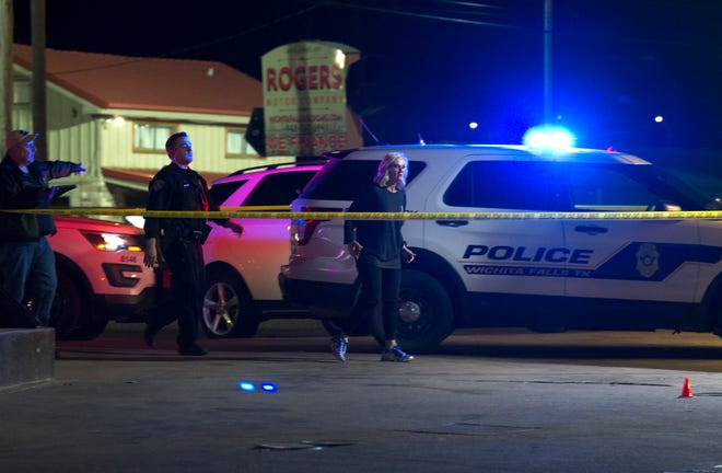 Wichita Falls police worked the scene of the murder of Bobby Joe Fernandez in the parking lot of a convenience store on Jacksboro Highway on March 6, 2021.
