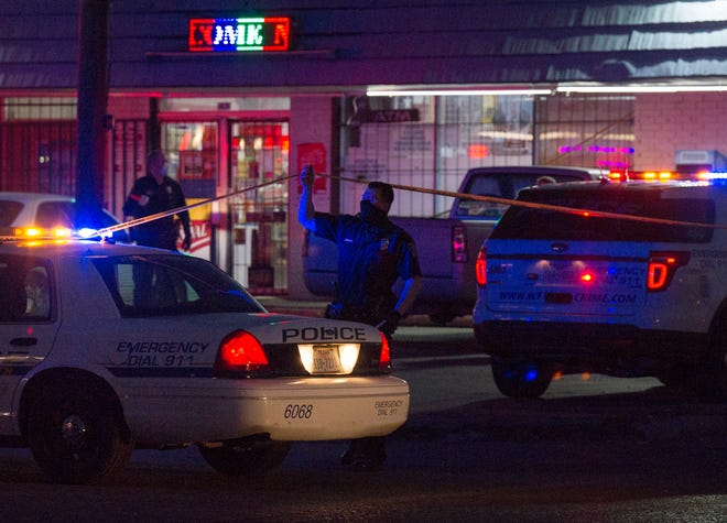 Wichita Falls police worked the scene of a murder in the parking lot of a convenience store on Jacksboro Highway Saturday night.