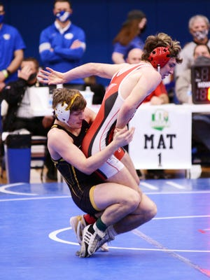 Tri-Valley's Cullen Van Rooyan takes down Lisbon Beaver Local's Devon Salsberry in the finals at 138 pounds during the Division II district tournament on Feb. 6 at Gallipolis Gallia Academy. Van Rooyan was among three Scotties to reach the state tournament.