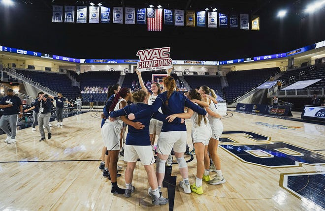 California Baptist University's women's basketball team celebrates after clinching the Western Athletic Conference regular-season title with a 79-64 victory over Grand Canyon University on Feb. 20.