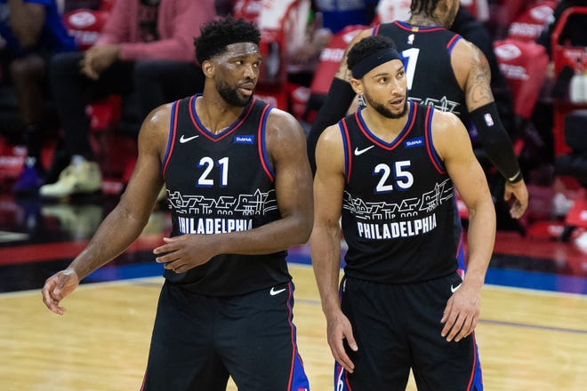 Philadelphia 76ers guard Ben Simmons (25) and center Joel Embiid (21) look on during a game earlier this season.
