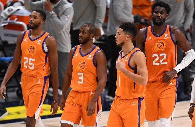 The Suns have been talking about competing for an NBA title, and they think players like Chris Paul (3) and Devin Booker can help carry them there.
