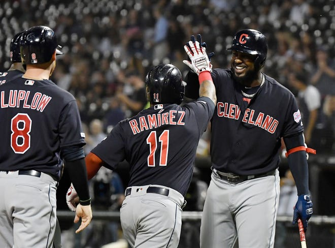 Cleveland designated hitter Franmil Reyes (32) congratulates third baseman Jose Ramirez (11) after a grand slam last season. Reyes and Ramirez are going to be counted upon to anchor the lineup in 2021. [USA TODAY Network]