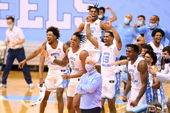 March 6: The North Carolina Tar Heels bench celebrates toward the end of the game against rival Duke at Dean E. Smith Center.