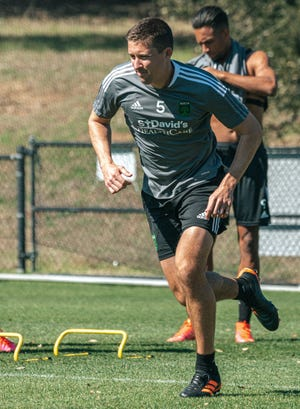 Austin FC defender Matt Besler looks for space during warm-up exercises as the club trains for the season at St. Edward's University.