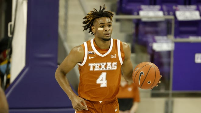 Texas forward Greg Brown had his ups and downs in Texas' win over TCU on Sunday, missing a dunk attempt rather than going for an easy layup that drew the ire of head coach Shaka Smart.