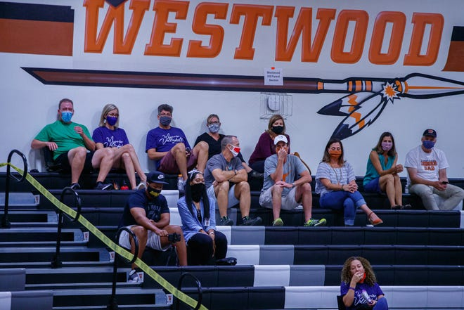 Fans don masks during a volleyball game at Westwood High School in the Round Rock school district in the fall. Gov. Greg Abbott will lift the statewide mask mandate this Wednesday, but virtually all of the school districts in the Austin area will continue to require masks at athletic events.