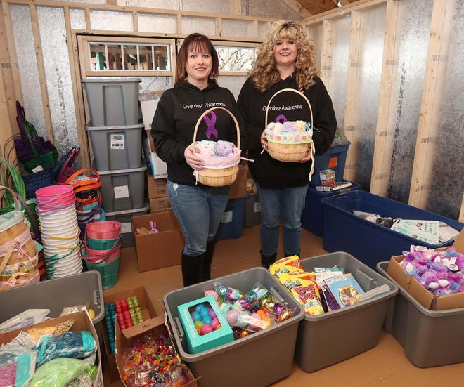 Beth Metheney, left, and her sister Emmy Cancel hold Easter baskets that will be distributed at Easter time to children of families touched by addiction. Metheney's daughter Lissy Garland died from an overdose in April 2020 and the sisters have formed Lissy's Legacy of Love to help children in families experiencing addiction.