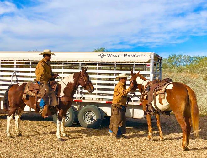 "Ramiro ""El Chicote"" Perez, Vaquero, and Isai Monroy Delgado, Ranchero, prepare to gather Wagyu cross-bred cattle at the Tasajillo Division of Wyatt Ranches."