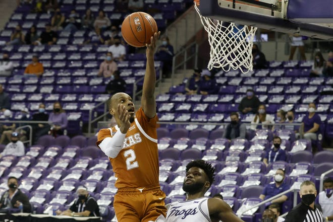 Texas guard Matt Coleman III shoots over TCU guard Mike Miles during the Longhorns' 76-64 win on Sunday. Texas closed the regular season with three straight conference road games in six days.