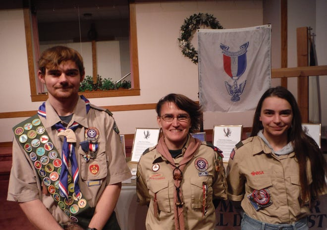 Eagle Scout Christopher Bartley, left, celebrated his designation during a recent event with Claudia Barr, center, and his sister, Kaela Bartley.