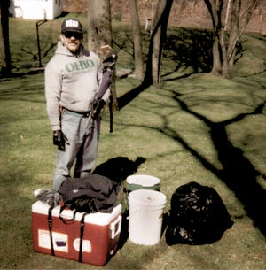 Ed Como shows off his portable rotisserie at the beginning of one of our canoe trips. The photo is a bit out of focus. But, in those days, so were we.