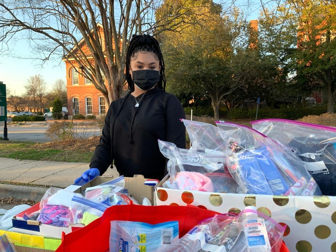 Skylar Moses, 20, of Evans spent time Sunday afternoon passing out donated toiletries, food and water to the homeless. The Augusta Technical College student and a group of friends were also collecting donations to be distributed to those in need during the event outside Sacred Heart Cultural Center.