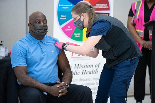 Superintendent Dr. Kenneth Bradshaw receives the COVID-19 vaccine from nurse Kim Allen in March of this year.