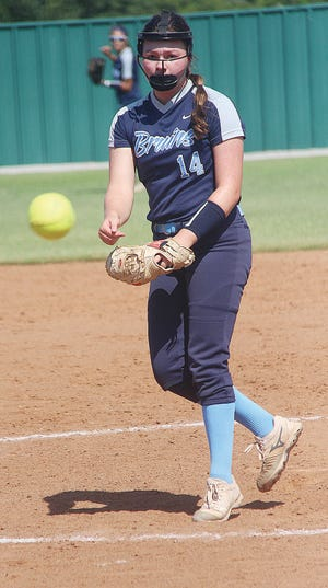 Caroline Pattison delivers a strike during her pitching days for Bartlesville High School.