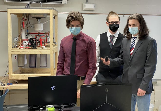 Caleb Cochran, Colton McCullough, and Bryce Goodin present their project virtually during the Bartlesville District Science Fair.
